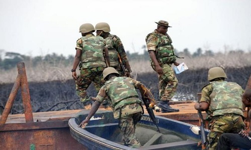Image result for Army destroys 143 illegal refineries in Niger Delta