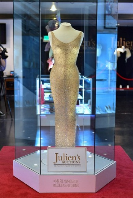 """The dress worn by Marilyn Monroe when she sang """"Happy Birthday Mr. President"""" to US President John F. Kennedy in May 1962, is displayed in a glass enclosure at Julien's Auction House in Los Angeles, California on November 17, 2016, ahead of its auction this evening. / AFP PHOTO / Frederic J. BROWN"""
