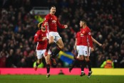 MANCHESTER, ENGLAND - JANUARY 15:  Zlatan Ibrahimovic of Manchester United (C) celebrates as he scores their first and equalising goal during the Premier League match between Manchester United and Liverpool at Old Trafford on January 15, 2017 in Manchester, England.  (Photo by Laurence Griffiths/Getty Images)