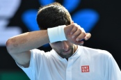 Serbia's Novak Djokovic reacts after a point against Uzbekistan's Denis Istomin during their men's singles second round match on day four of the Australian Open tennis tournament in Melbourne on January 19, 2017. / AFP / PAUL CROCK / IMAGE RESTRICTED TO EDITORIAL USE - STRICTLY NO COMMERCIAL USE        (Photo credit should read PAUL CROCK/AFP/Getty Images)