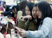 SOUTH KOREAN WOMEN SHOP CHOCOLATE FOR THEIR LOVERS IN SEOUL.